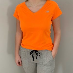 Bright orange new balance shirt